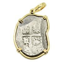 Spanish 4 reales 1700-1715, in 14k gold pendant, 1715 Treasure Fleet Shipwreck, Florida.