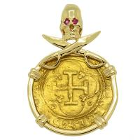 Spanish 1516-1556, Johanna and Charles I one escudo in 14k gold Skull and Swords pendant with ruby eyes.