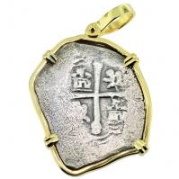 Spanish 4 reales 1700-1715, in 14k gold pendant, 1715 Treasure Fleet Shipwreck, Florida.